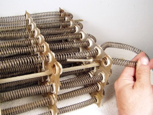 Carefully pull out the old heating element wire.  Keep one element in tact, cut the rest for removal ease.